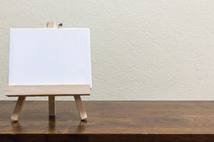 Empty whiteboard on the wooden table. Empty blank whiteboard on the wooden table Royalty Free Stock Images