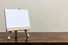 Empty whiteboard on the wooden table. Empty blank whiteboard on the wooden table Stock Images