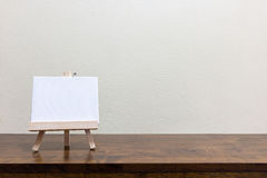 Empty whiteboard on the wooden table. Empty blank whiteboard on the wooden table Royalty Free Stock Photos