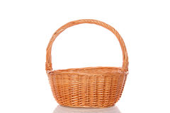 An empty wicker basket. Isolated on white background Royalty Free Stock Photography