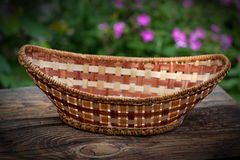 Empty wicker basket against old wooden planks Stock Image