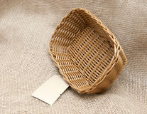 Empty wicker basket on the background fabric. New wicker basket on the background of burlap stock images