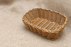 Empty wicker basket on the background fabric Royalty Free Stock Photo