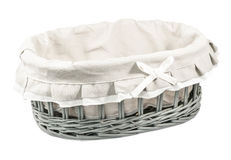 Empty wicker basket. Beautiful empty wicker basket covered with decorative linen cloth isolated on white background stock image