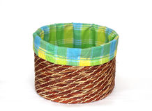 Empty wicker basket with coloured cloth on a white stock photos