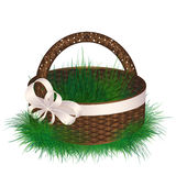 Empty wicker basket decorated ribbon with bow Royalty Free Stock Image