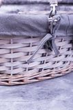 Empty wicker basket on gray background. Beautiful basket for Easter. Equipment for Easter celebrations Royalty Free Stock Photos