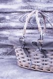 Empty wicker basket. Gray easter basket on gray background. Going to church for a holiday Royalty Free Stock Photos