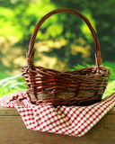 Empty wicker basket and plaid for picnic Royalty Free Stock Image