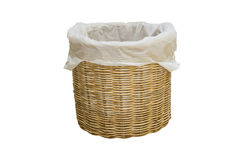 Empty wicker basket with plastic bag isolated on white Stock Photography