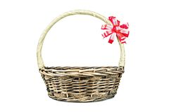 Empty wicker basket with red and gold ribbon isolated on white stock photography