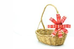 Empty wicker basket with red and gold ribbon on white b stock images