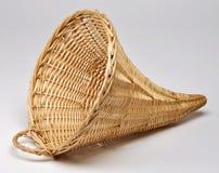 Empty wicker basket in the shape of cornucopia Stock Image