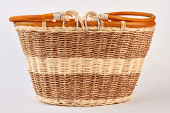 Empty wicker basket, white background. Wooden brown basket isolated stock photography