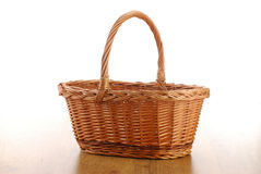Empty wicker basket on wooden table Stock Photos