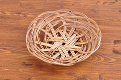 Empty wicker basket on wooden table background. View from above royalty free stock photos