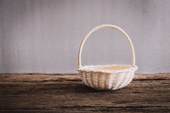 Empty wicker Basket on wooden tabletop Stock Photos