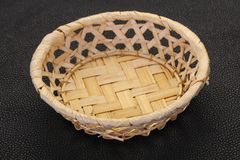 Empty wicker bowl. Over black background royalty free stock images