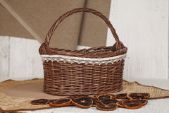 Empty wicker brown basket  for fruit and bread in cozy backgrou Stock Photography