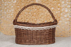 Empty wicker brown basket  for fruit and bread in cozy backgrou Royalty Free Stock Photo
