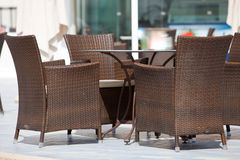 Empty wicker chairs around a table Stock Photo