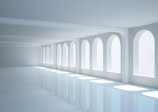 Empty wide hall with columns and arched windows Royalty Free Stock Image