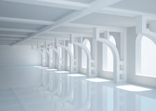 Empty wide room with decorative columns and arched windows Stock Photos