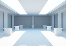 Empty wide room with exposition pedestals Royalty Free Stock Photography