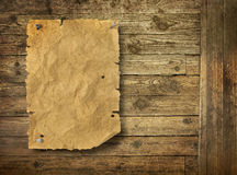 Empty Wild West wanted poster. On old wooden wall stock photos