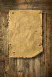 Empty Wild West wanted poster. On wooden wall royalty free stock photos