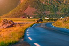 Empty road in Norway, Europe. Sunset travel Stock Images