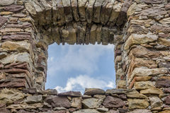 Empty window hole giving view to blue sky Royalty Free Stock Photography