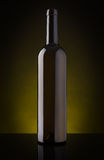 Empty wine bottle without label. On a dark background Stock Photos