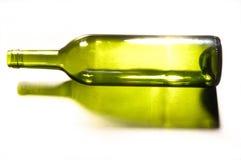 Empty wine bottle on white stock photography