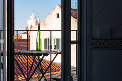 Empty Wine Bottle on Wooden Balcony Table over Alfama European V. Acation Beautiful Day Relaxing Stock Photo