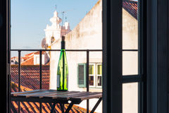 Empty Wine Bottle on Wooden Balcony Table over Alfama European V. Acation Beautiful Day Relaxing Royalty Free Stock Photos