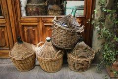 Empty wine bottles in wicker baskets Royalty Free Stock Photography