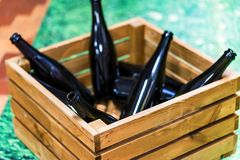 Empty wine bottles in wooden box royalty free stock photos
