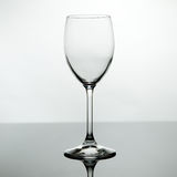 Empty wine glass. Backlighted Empty wine glass with reflection Royalty Free Stock Images