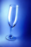 Empty wine glass. With blue background royalty free stock photos