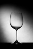 Empty wine glass. Against studio background. Tilted image Stock Photography