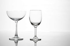 Empty wine glass and cocktail glass art composition creative. Background royalty free stock image