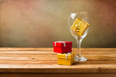 Empty wine glass with gift boxes Royalty Free Stock Photos