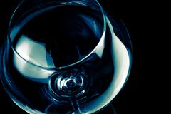 Empty wine glass and light tint blue disco Stock Image