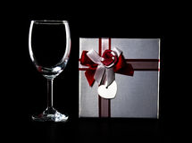 Empty wine glass and present Royalty Free Stock Photography