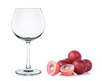 Empty wine glass with red grape isolated Royalty Free Stock Photography