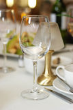 Empty wine glass in table restaurant. Wine glass standing on table in beautiful restaurant Stock Photos