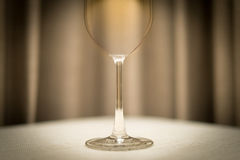 Empty wine glass on table in restaurant. Royalty Free Stock Photos
