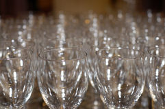 Empty Wine Glasses. Rows of wine glasses behind the bar at a hotel during a wedding reception Stock Images