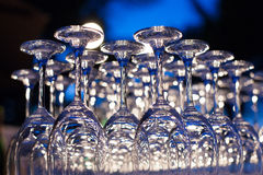 Empty wine glasses arranged in row. Royalty Free Stock Photo